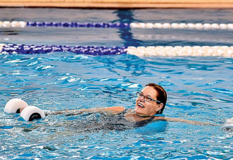 Julie Shepherd, of West Bloomfield, swims in an intermediate water aerobics class at the Farmington Family YMCA on April 10.(Photo by Deb Jacques, C and G News.)