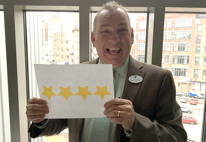 Scott Landry celebrating our 4 star rating