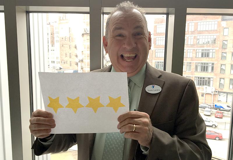 Scott Landry celebrating our 4 star rating